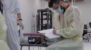 Researchers at NeuRA conducting spinal cord stimulation trials with the DS8R stimulator